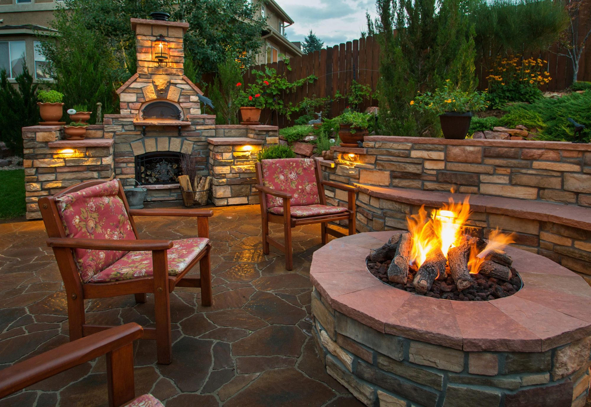 amazing backyard with pizza oven and fire pit